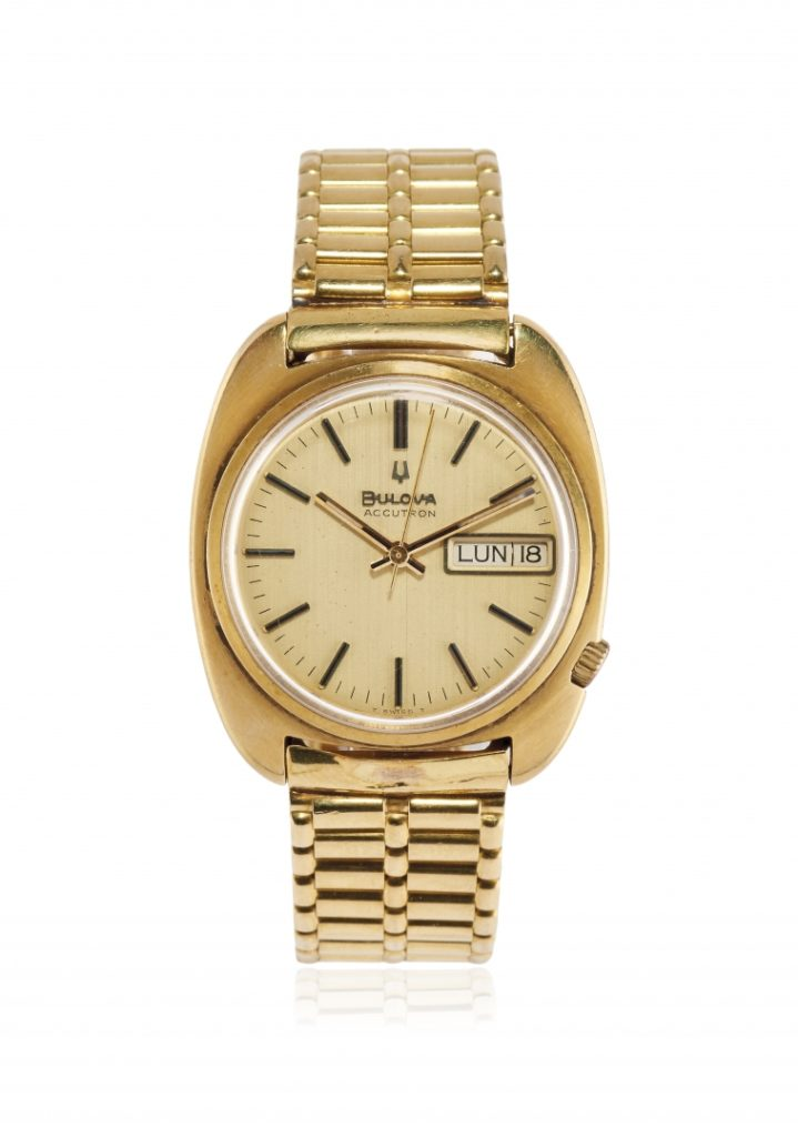 bulova accutron 18k gold